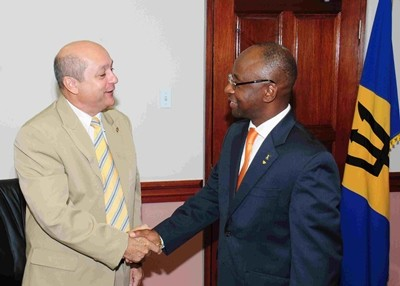 Minister of Culture, Sports and Youth, Stephen Lashley greets Cuban Ambassador to Barbados, Francisco Fernández Peña at their meeting today. (B.Hinds/BGIS)
