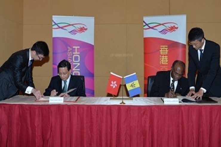 Barbados' Ambassador to China, Dr. Chelston Brathwaite (right) and Secretary for Transport and Housing, Professor Anthony Cheung Bing-leung signing the agreement in Hong Kong.