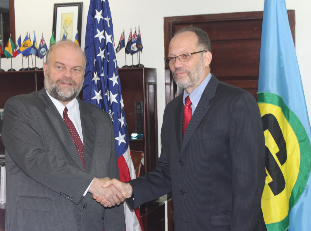 CARICOM Secretary-General Ambassador Irwin LaRocque welcomes new United States Ambassador to CARICOM H.E. Perry Holloway at the CARICOM Secretariat Headquarters, Georgetown, Guyana, Tuesday.