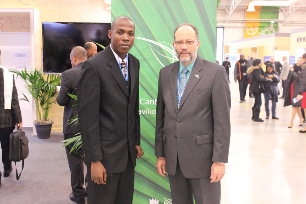 CARICOM Secretary-General, Ambassador Irwin LaRocque (r) and Caribbean Youth Environment Network's Special Envoy Mr. Stefan Knights meet outside the Caribbean Pavilion at COP 21, Paris France