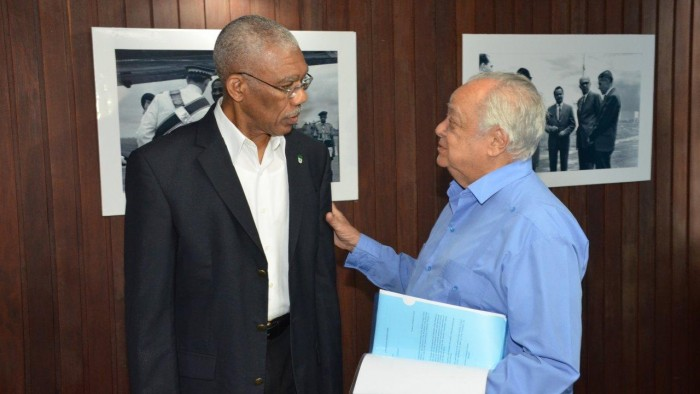 President David Granger and Sir Shridath Ramphal share a light moment, during yesterday's meeting.