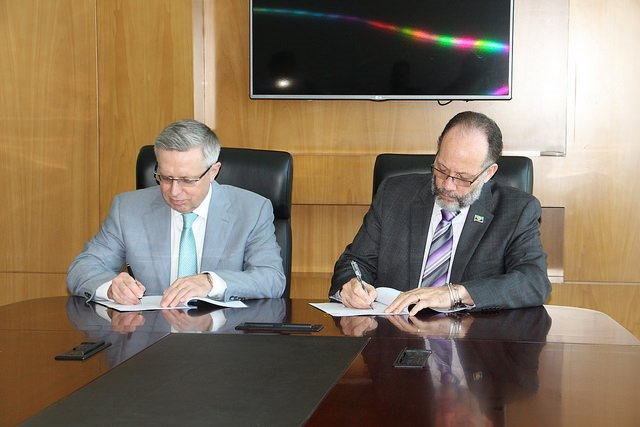 Signing of the Agreement - CARICOM Secretary-General Amb. Irwin LaRocque (right) and Kazakhstan's Ambassador His Excellency Mr. Konstantin Zhigalov.