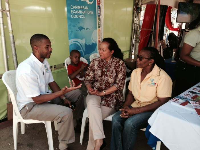 CXC Assistant Registrar Public Information and Customer Service, Mr. Cleveland Sam, elaborates on the new CAPE syllabuses to Deputy Progamme Manager, Culture at the CARICOM Secretariat Ms. Riane DeHaas Bledeog and Dr. Annette Piper, CXC Assistant Reg
