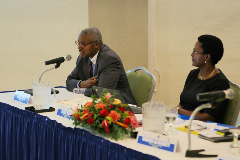 Edward Greene, Division Chief, Technical Cooperation Division, CDB (left) and Muriel Mafico, Deputy Representative, UNICEF (right), during the Midterm Review Meeting on Monday, March 14, 2016.