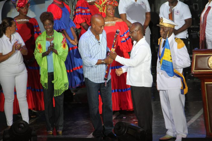 Haiti's President H.E. Michel Martelly passes the CARIFESTA Baton to Barbados Minister of Culture Hon. Stephen Lashley at CARIFESTA XII closing ceremony in August 2015 (CARICOM Secretariat file photo)