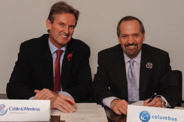 FLASHBACK: Phil Bentley, the then chief executive officer of Cable and Wireless Communications (left) and Brendan Paddick, CEO and chairman of Columbus Communications after signing the proposed merger agreement back in November 2014. (Photo credit ca