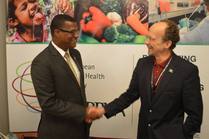 Premier of Turks and Caicos Islands, Dr. Rufus Ewing and CARPHA Executive Director, Dr. James Hospedales greet each other at the Meeting (Photo via CARPHA )