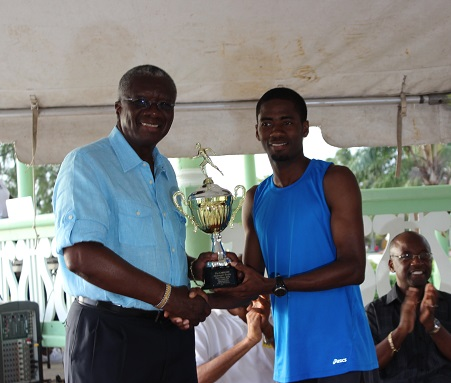 Flashback: CARICOM 10K veteran receives champion's trophy from the Hon Freundel Stuart, Prime Minister of Barbados