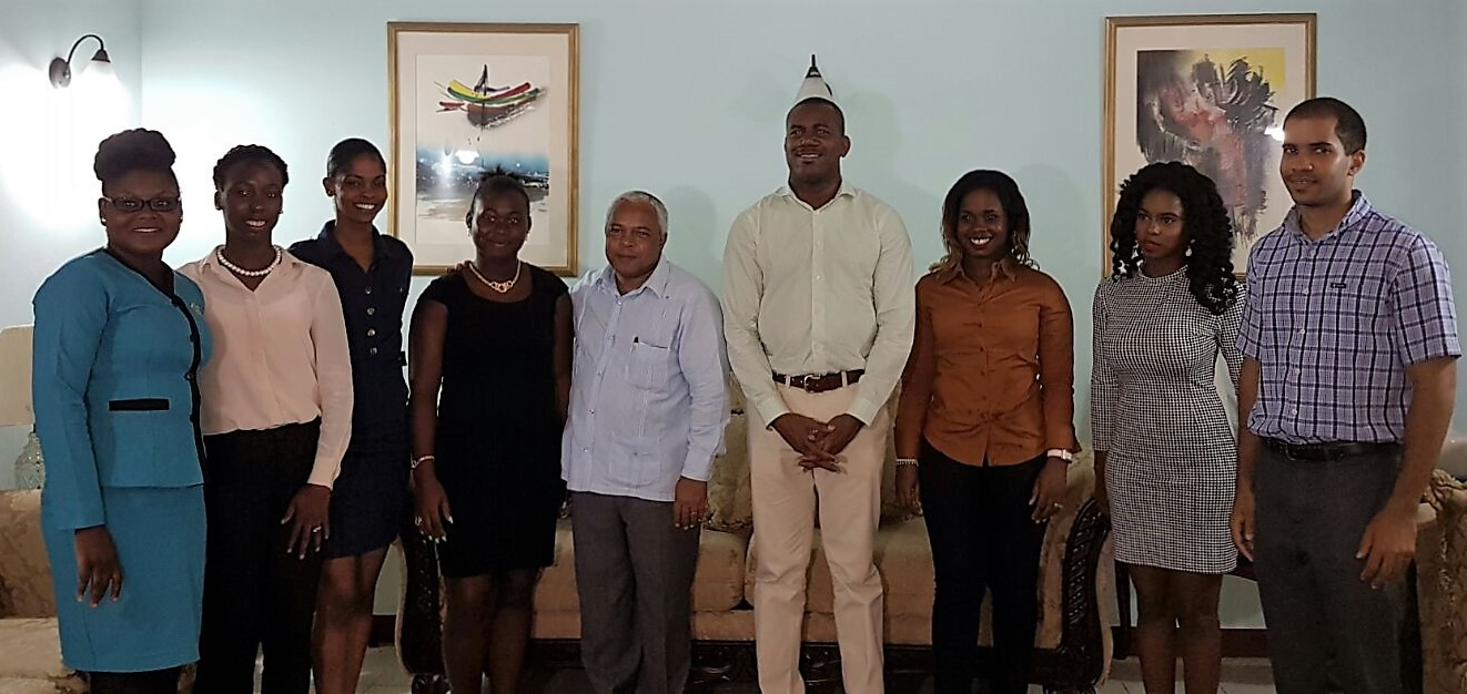(L-R): Monique Harry; Ava Spencer-Crawford; Carrie Bussue; Jeffvancia Matthew, H.E. Ambassador Hugo Ruiz Cabrera; Honourable Shawn Richards; Simoneth Williams; Tishima Browne; Andre Hanley