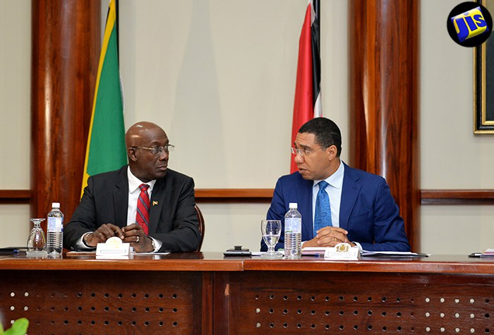 Jamaica's Prime Minister Mr. Andrew Holness (right) and his Trinidad and Tobago counterpart Dr. Keith Rowley brief the media ahead of bilateral talks (photo via JIS)