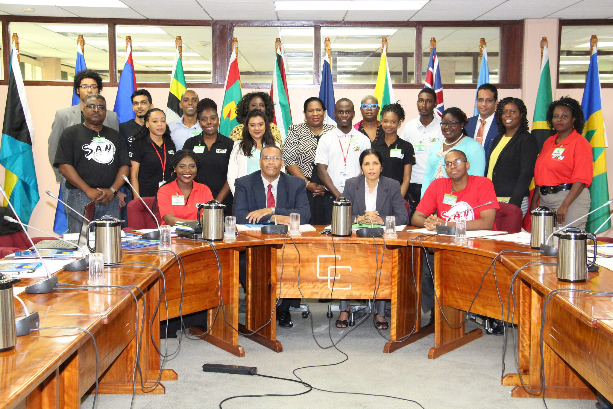 Amb. Manorma Soeknandan and Mr. Joseph Cox (seated, centre) with the visitors and CARICOM Secretariat staff members.