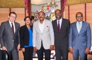 Antigua and Barbuda's Prime Minister Gaston Browne (centre), stands with (left to right): Dr Warren Smith, President of the Caribbean Development Bank; Onika Miller, Executive, Government Relations and Public Policy, Jamaica National Building S