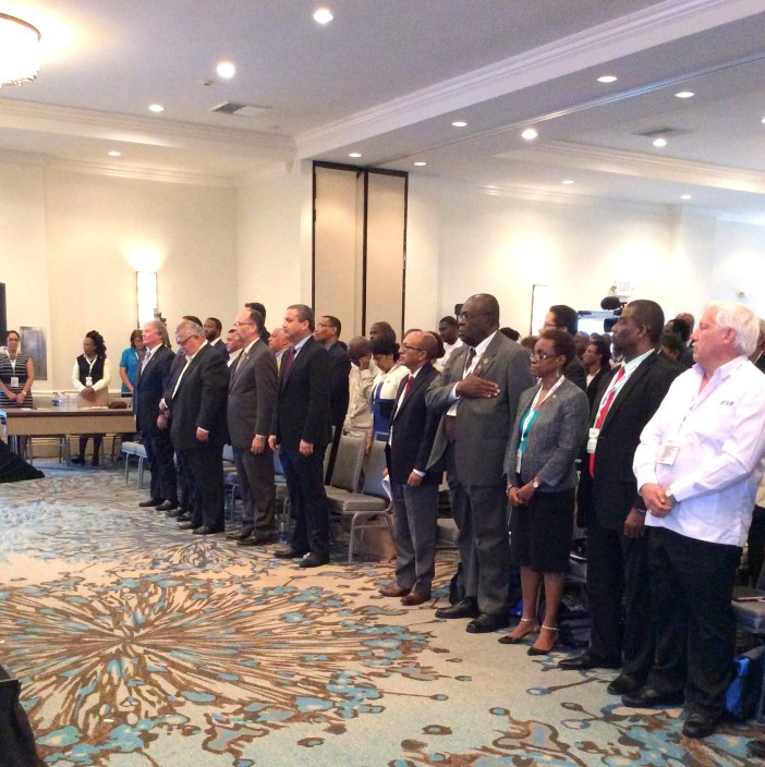 Delegates stand as the CARICOM song was played at the Opening Ceremony of the Caribbean Week of Agriculture 2016, at the Westin Resort, Grand Cayman, Cayman Islands