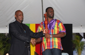 CARICOM Youth Ambassador Charde Dessir accepts the Reparations baton from Mayor of Castries His Worship Peterson Francis