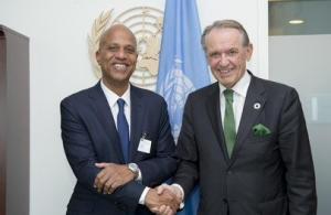Belize PM Hon. Dean Barrow (left) with UN Dep. Secretary-General after signing