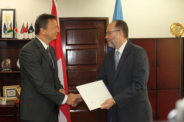 Amb. Mr. LaRocque (r) receives the Letters of Credence from H.E. Mr. Chasot
