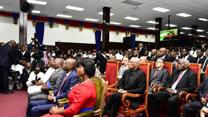President David Granger during the Swearing in Ceremony of the new Haitian President, His Excellency Jovenel Moise. President Moise sits beside his wife Martine in the front row during the Ceremony. (Photo via Ministry of the Presidency)