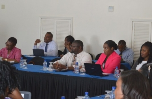 Donovan Herbert (centre) amongst participants at the LMIS workshop (Photo via SKNIS)