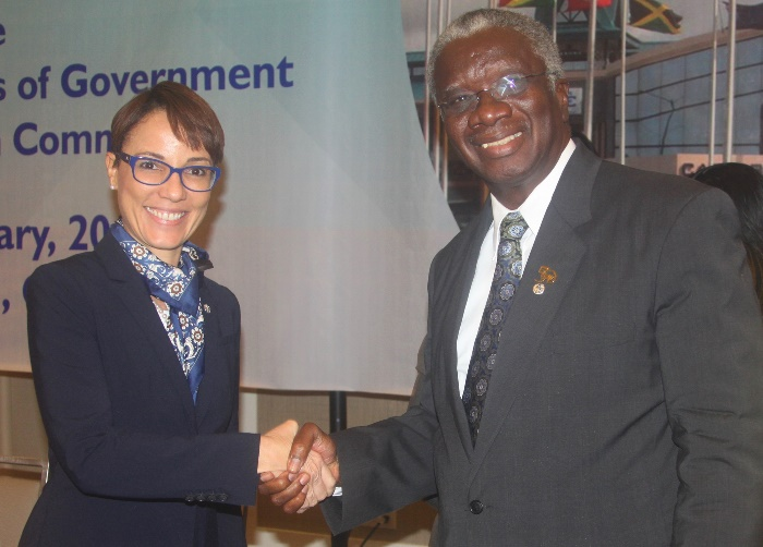 Prime Minister Freundel Stuart of Barbados; and the Minister of Foreign Affairs and Foreign Trade of Jamaica, Senator Kamina Johnson Smith, participating in a photo opportunity following their ratification of protocols on behalf of their respective c