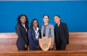 Mrs.	Jacqueline	Graham, (left)	presents	the	award	for	'Best	Academic	Institution'	to	Team UWI,	Cave	Hill	Campus	(Photos via CCJ) All	female	winning	team	from	the	Eugene	Dupuch	Law	School