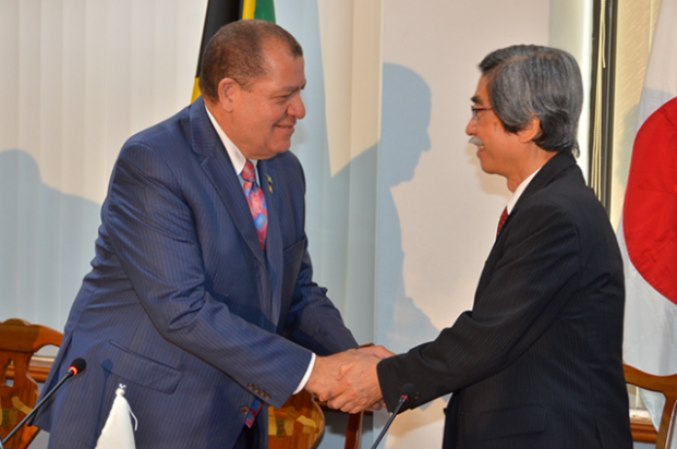 Finance and the Public Service Minister, Hon. Audley Shaw (left), greets Japan's Ambassador to Jamaica, Ambassador Masanori Nakano, during Wednesday's (April 12), signing ceremony for the implementation of a $348.9 million (¥300 milli