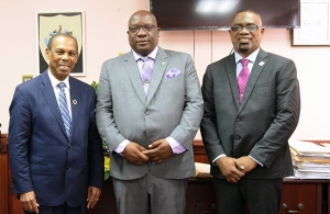 Prime Minister Dr. Timothy Harris (centre) with Dr. Edward Greene, UN Secretary-General's Special Envoy for AIDS in the CARIBBEAN (left), and Deryck Springer, Director of PANCAP