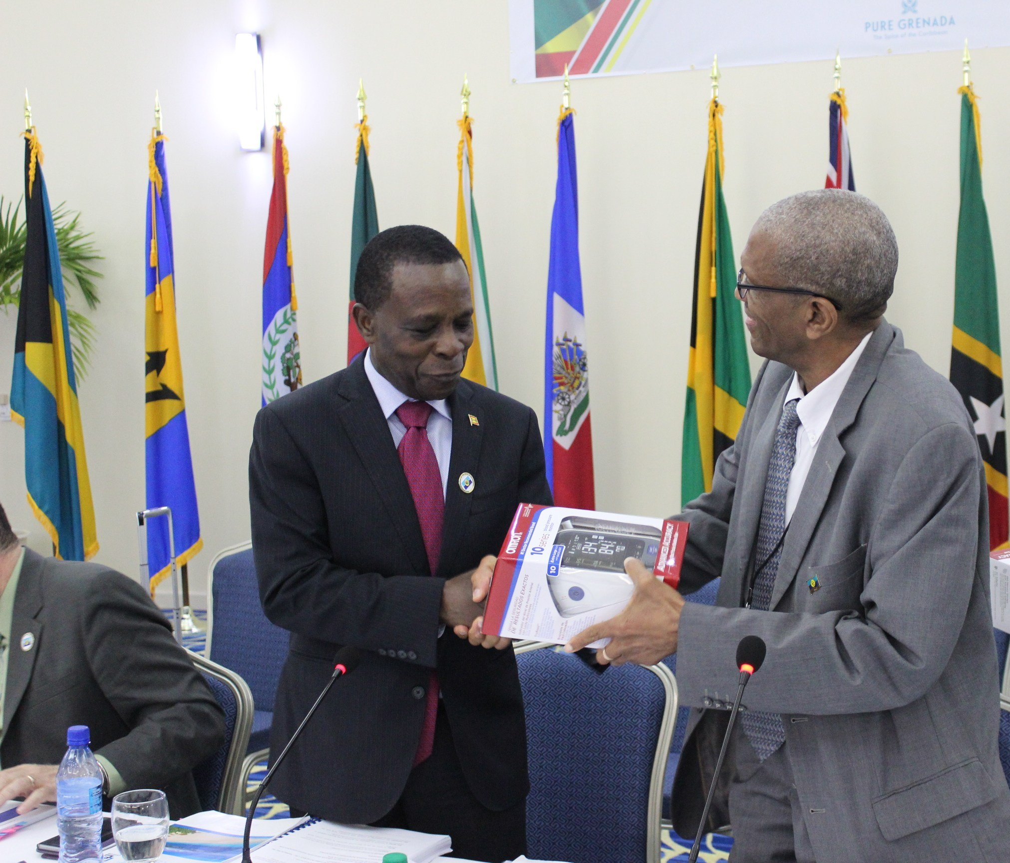 CARICOM Chairman, Prime Minister Dr. Keith Mitchell of Grenada receives a Blood Pressure Apparatus from CARICOM Assistant Secretary-General Human and Social Development, Dr. Douglas Slater