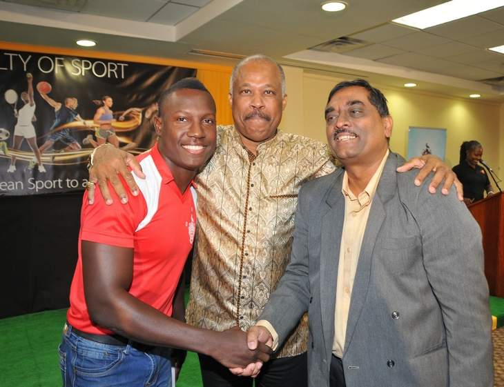 COMBINING FORCES: West Indies cricketer, Rovman Powell, left, The University of the West Indies Vice-Chancellor, Professor Sir Hilary Beckles, centre, and Dean of the Faculty of Sport, Dr Akshai Mansingh share a light moment at the official launch of