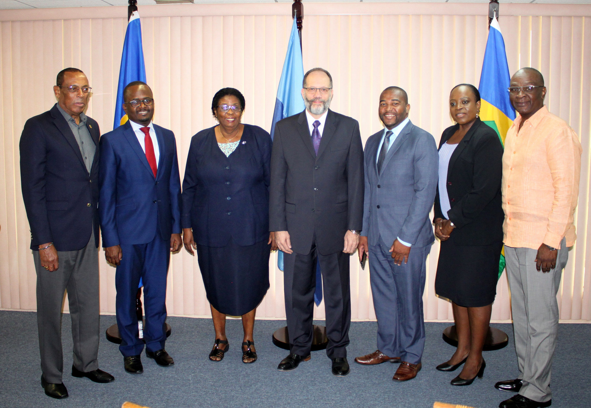 Fellow Ambassadors and the Secretary-General pose with the Ambassadors of Barbados  (3rd left) and SVG (3rd right)