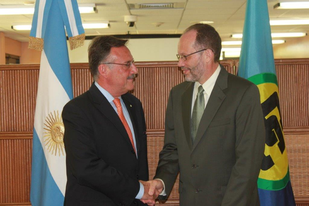 Secretary General Ambassador Irwin LaRocque, shakes hands with newly appointed Argentine Ambassador to CARICOM, H.E. Luis Alberto Martino, following an official ceremony at the CARICOM Secretariat where the Argentine Ambassador presented his letters