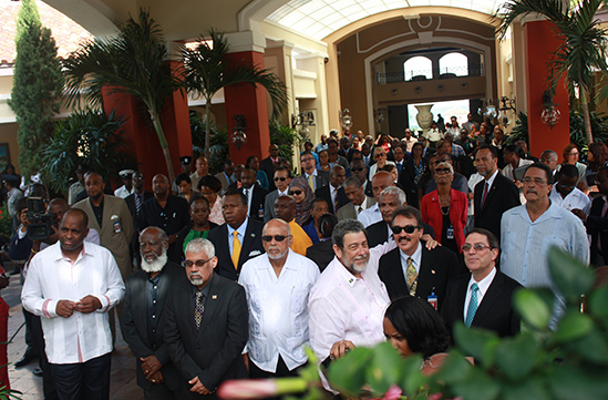 CARICOM Day, Friday 4 July 2014, was celebrated at the ongoing 35th CARICOM Heads of Government conference in Antigua/Barbuda with a flag raising ceremony. The Heads joined other participants outside the conference venue for the raising of the Antigu
