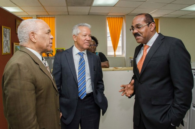 Minister of Transport, Works and Housing, Dr. the Hon. Omar Davies (left), having a light discussion with Prime Minister of Antigua and Barbuda, Hon. Gaston Browne (right) and Director General of the Maritime Authority of Jamaica, Rear Admiral Peter