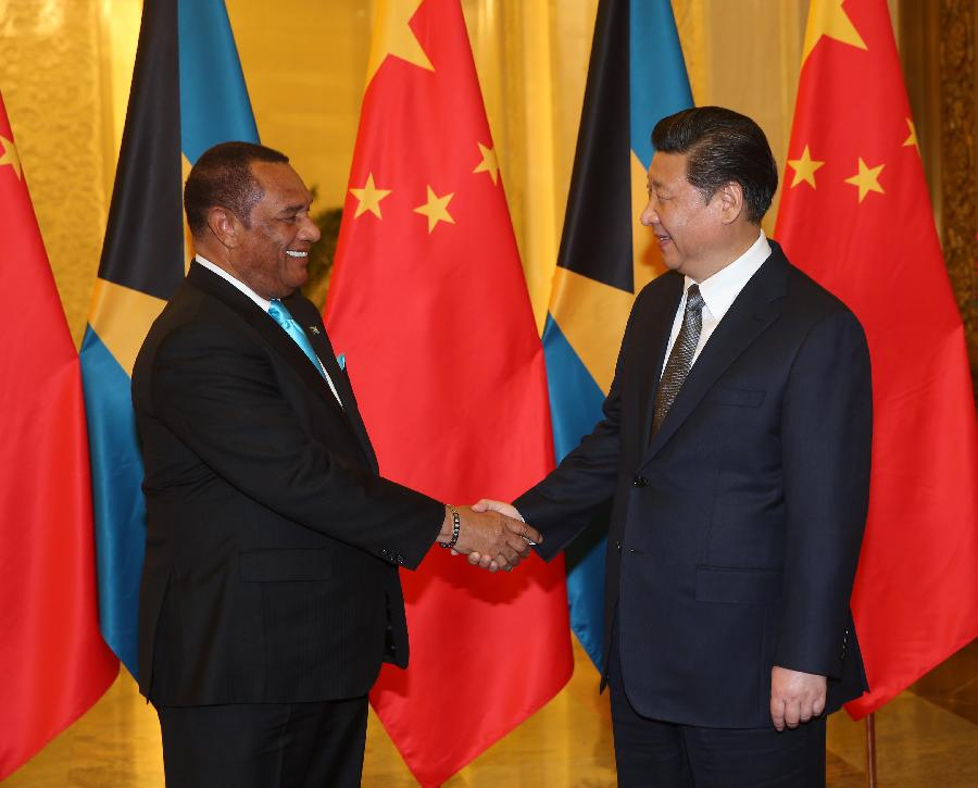 CARICOM Chairman, Prime Minister of The Bahamas Perry Christie (L) meets Chinese President Xi Jinping in Beijing, capital of China, ahead of Thursday's start of the first Ministerial meeting of the Forum of China and the Community of Latin Amer