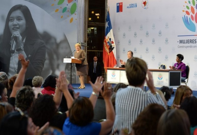 """Chilean President Michelle Bachelet during the closing ceremony of the international meeting """"Women in power and decision-making: Building a different world"""". On the podium, U.N. Secretary-General Ban Ki-moon and U.N. Women Executive Dire"""