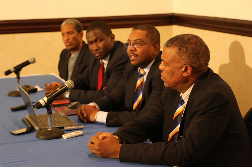 Dr. Douglas Slater, Assistant Secretary-General, CARICOM Secretariat (left), Wavell Hinds, President of WIPA (2nd left), and Michael Muirhead, Chief Executive Officer of WICB (right) listen to re-elected WICB President Dave Cameron, following the Ann