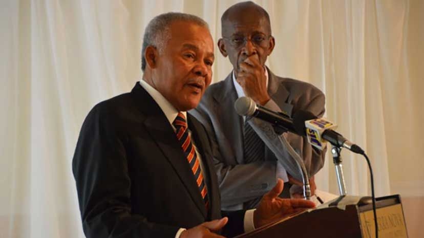 Former Barbadian Prime Minister, Owen Arthur (left) giving the keynote address on Thursday, July 16, at the Partnership for Jamaica retreat, chaired by Prime Minister, the Most Hon. Portia Simpson Miller, at the Terra Nova Hotel. Listening closely is