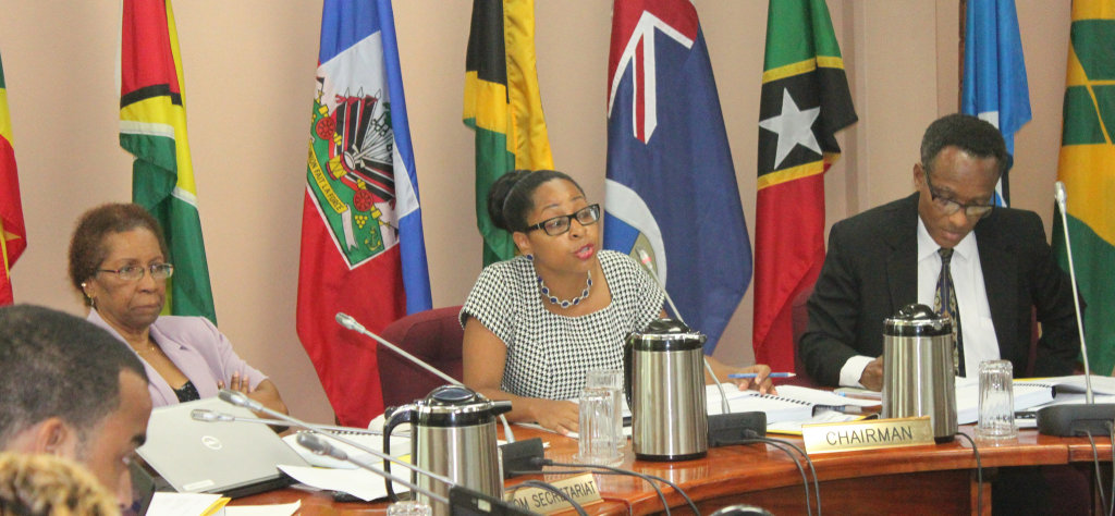 Ms. Desiree Field-Ridley, Officer-in-Charge, Trade and Economic Integration Directorate, CARICOM Secretariat, and Mr. Timothy Odle, Deputy Programme Manager, Services, flank Ms. Valique Gomes, Permanent Secretary (ag), Ministry of Economy and Trade,
