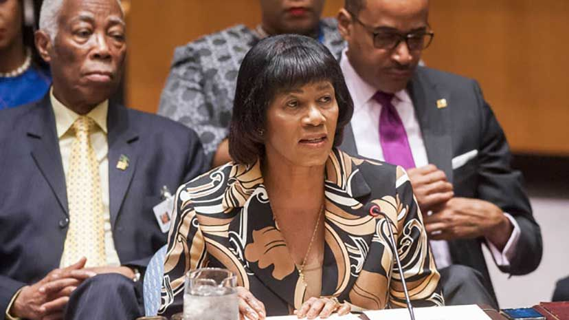 Prime Minister Portia Simpson Miller addresses the United Nations Security Council and the UN Headquarters in New York on Thursday, July 30. In the background at left is Minister of Foreign Affairs and Foreign Trade, Senator the Hon. AJ Nicholson QC,