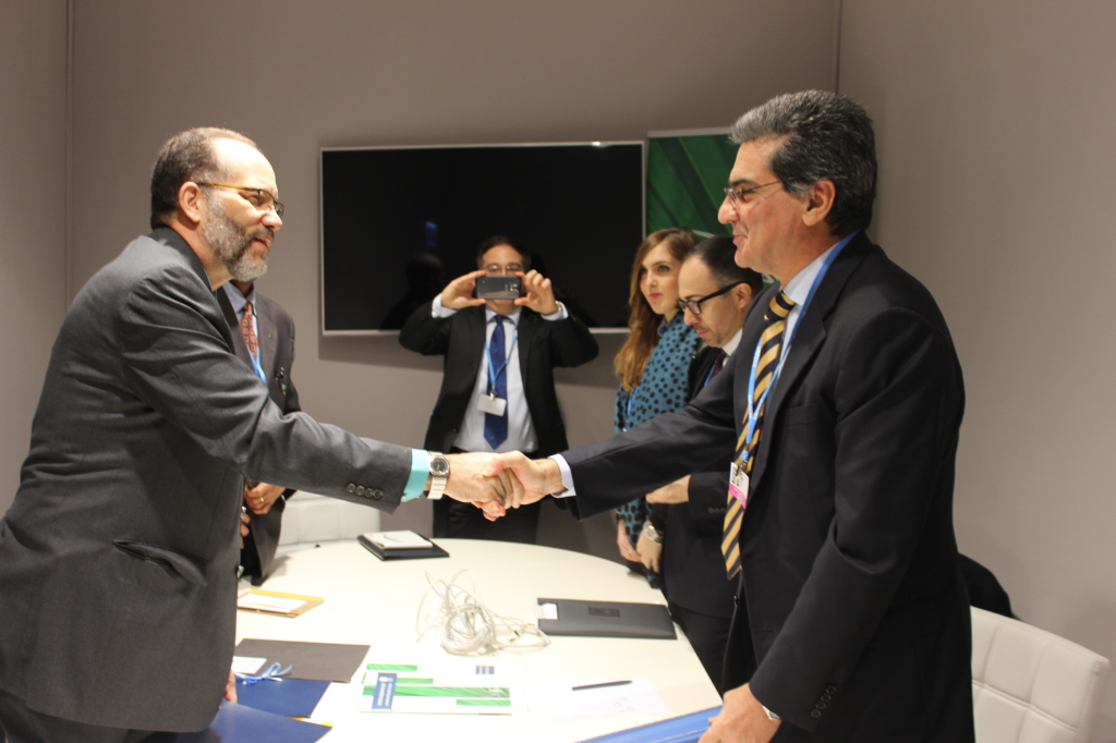 CARICOM Secretary-General Ambassador Irwin LaRocque (l) shakes hands with Italian Special Envoy for the Countries of the Caribbean Paolo Serpi