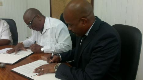 CEO of the CDF, Rodinald Soomer and Guyana's Minister of Finance, Winston Jordan, as they signed a supplementary loan agreement for Guyana's CAP in the CDF's first funding cycle, which went towards a major road programme to improve