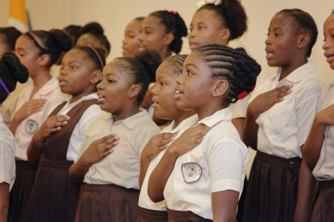 Students of the James Garbutt SDA School Choir perform the National Anthem during the launch of Phase Two of the Belize Education Sector Reform Programme in Belize City on January 27, 2016. (Photo via CDB)