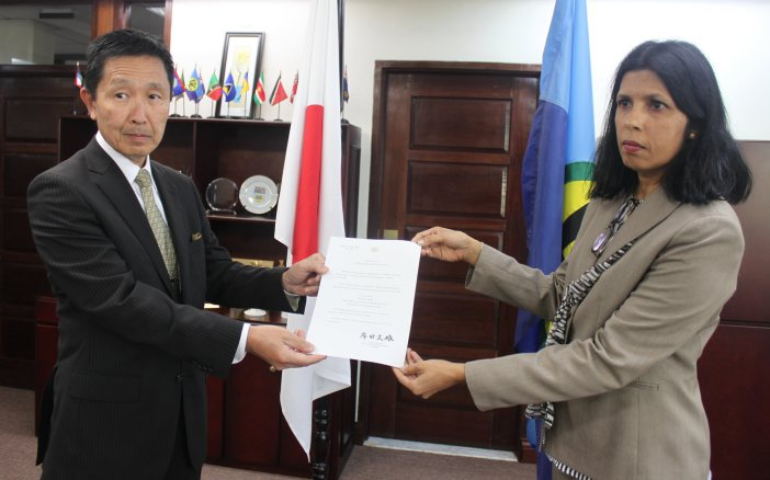 Plenipotentiary Representative of Japan to the Caribbean Community (CARICOM), His Excellency Mitsuhiko Okada and Deputy Secretary-General of CARICOM, Ambassador Manorma Soeknandan (PhD), display his credentials on Thursday, 25 February, 2016, at the