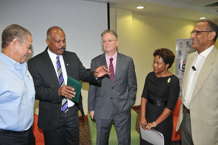 Vice Chancellor of The University of the West Indies (UWI), Sir Hilary Beckles (second right) makes a point at the UWI Forum on Brexit. With him are (l-r) Bruce Golding, Chair of Jamaica's CARICOM Review Commission; British High Commissioner to