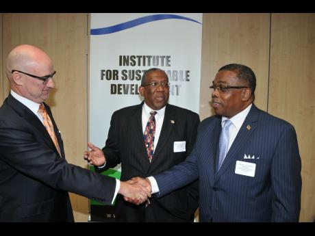 WI Pro Vice Chancellor Dr. Dale Webber (center); Minister Liburd (right) greets Bruno Pouezat, UN Resident Coordinator/United Nations Development Programme Resident Representative