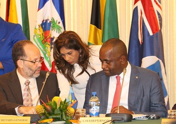 Chair of the Community, Prime Minster Roosevelt Skerrit of Dominica and CARICOM Secretary-General in discussion with a delegate before the start of the plenary sessions on Tuesday morning