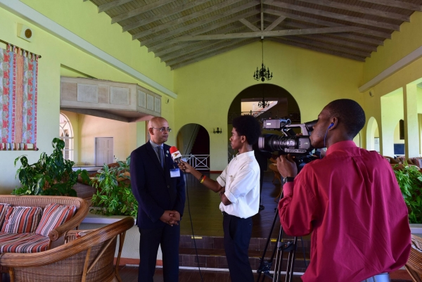 CROSQ CEO Mr Deryck Omar speaking to media after the opening of the workshop.
