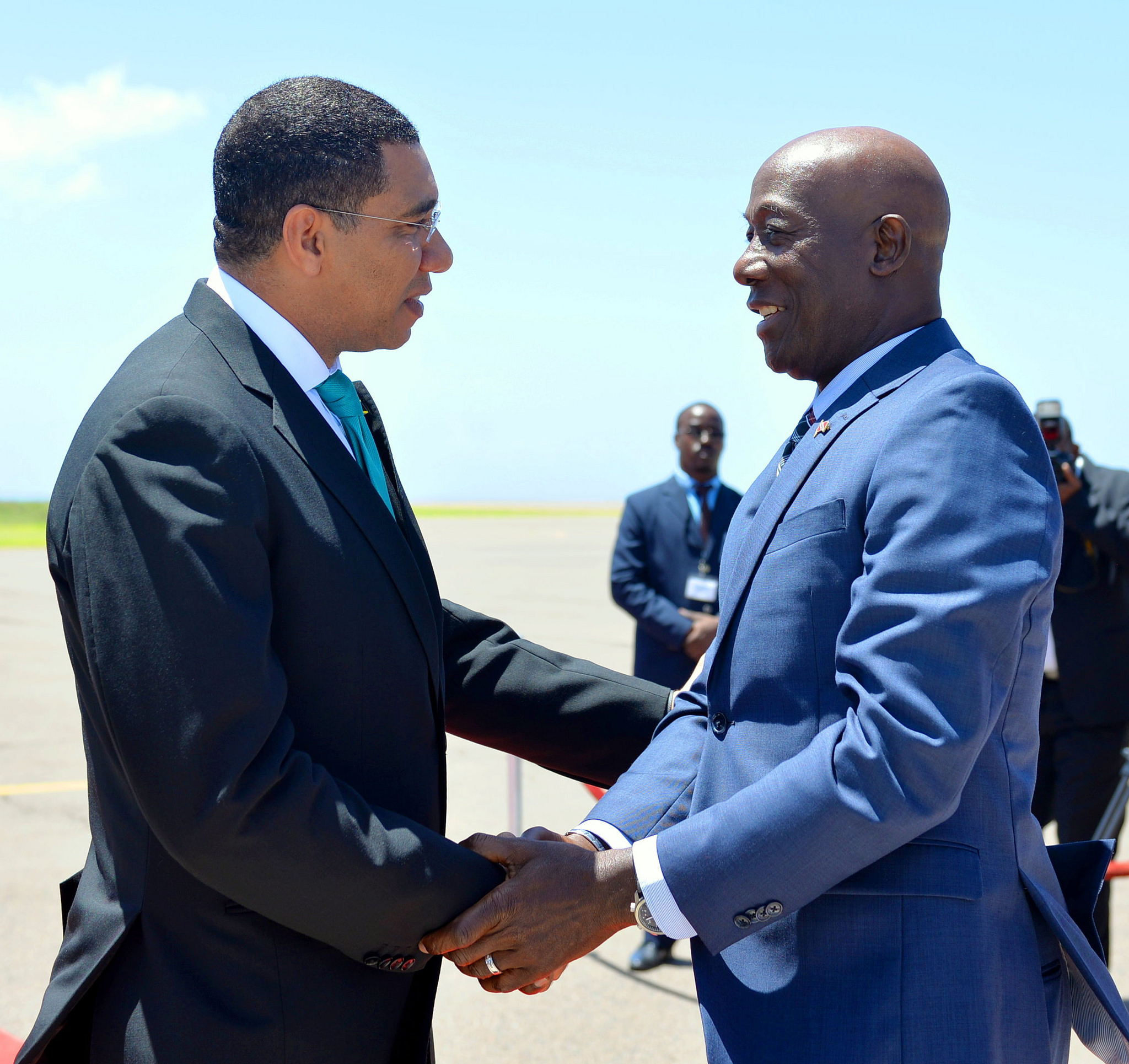 Prime Minister the Most Hon. Andrew Holness (left), greets Dr. the Hon. Keith Rowley, Prime Minister of Trinidad and Tobago, on his arrival at the Norman Manley International Airport today (July 17), for the start of an Official Visit to the island.