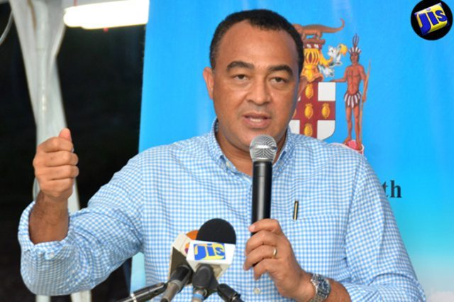 Minister of Health, Dr. the Hon. Christopher Tufton addresses Town Hall Meeting at the Sandy Bank Primary School in Treasure Beach, St Elizabeth, on July 21. (Photo via Jamaica Information Service)
