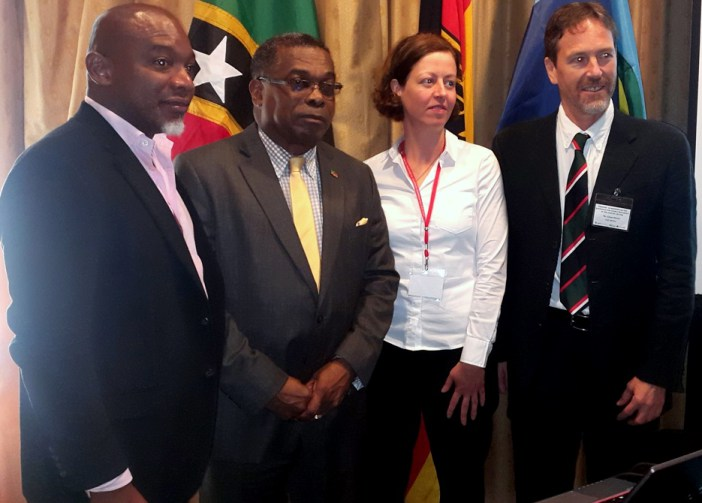 Dr. Gardener (left) and Minister Liburd (2nd from left) and officials from GIZ (Photo via St Kitts and Nevis Information Service)