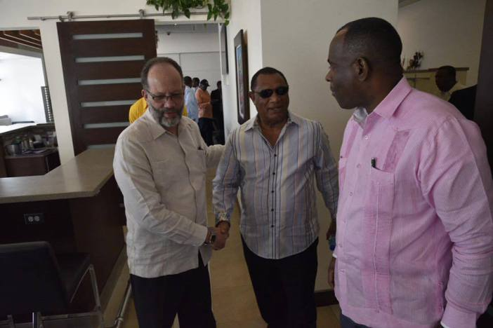 Prime Minister of The Bahamas Hon. Perry Christie greets CARICOM Secretary-General Ambassador Irwin LaRocque while CARICOM Chairman, Prime Minister Roosevelt Skerrit of Dominica looks on (Photo via Dominica PM's Office)